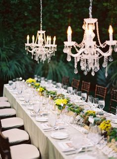 Out door elegant setting for gay wedding at Parker Palm Springs. Decor by Maggie Jensen Florals; photography by Michael Radford, design  planning by Celebrations of Joy.