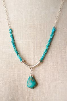 Turquoise is showcased beautifully as the focal of this pendant necklace. Perfect for wearing alone or layered, a great addition to your designer jewelry collection! Sterling silver chain and componen