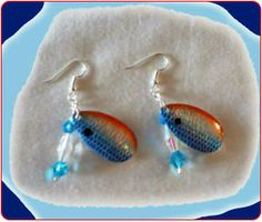 http://diginanchors.com/EarringsAlure_BlueWaterCoral - Has the beautiful orange and blue colors that a diver might find while exploring the depths of the Gulf of Mexico along the wonderful coral reefs. Sparkling czech beads of crystal blue and clear are added to enhance the beauty of the earrings. Surgical stainless steel earwires or adjustable lever action clips are used to hang the earrings.