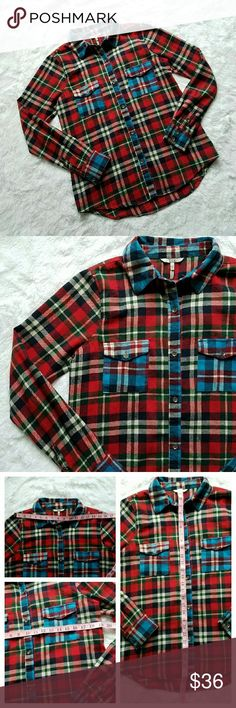 {BKE} Fitted Plaid Flannel Soooo soft, warm, and cozy! Awesome, slim fit flannel from The Buckle. Plaid/checkers with red, blue, white, green, gray colors woven in. Long sleeved. A little longer than most flannels, which is nice. Very thick, soft material. Not cheap! Vibrant and perfect on its own, or layered under a leather jacket or sweater. EUC, only worn a couple times.   ***20% off bundle discounts | Offers welcome! | NO TRADES | No modeling | Modeled pic is not actual item, nor my…
