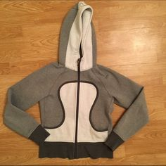Lululemon Scuba Hoodie Lululemon Scuba Hoodie - size 4 (size tag located in pocket) some slight pilling a few cuts in the wrists. lululemon athletica Sweaters