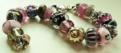 Pink, Black and Grey!!  Such great gold and silver beads!  http://www.trollbeadsgallery.com/categories/Beads/Silver-and-18-K-Gold/