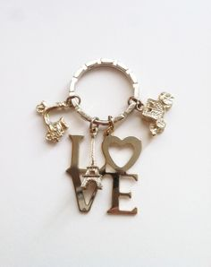 Love Travel in Paris keychain plated in 14k rose gold. S$38.90