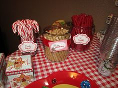 I absolutely love dressing up my food and candy bars with cute themed printables. The printables I used for my Holiday Party were from Bird's Party called Christmas Candyland Party Collection.