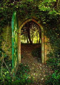 A gateway in the churchyard wall of the ruined 13th century parish church of Greatham in Hampshire