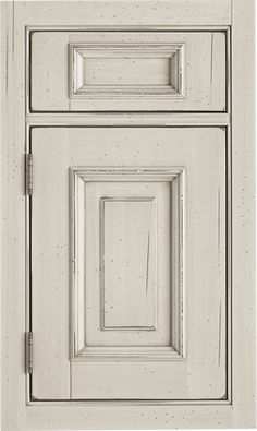 Pavilion Raised door style by #WoodMode, shown in distressed Cottage Lace finish with Brown undercoat on maple.