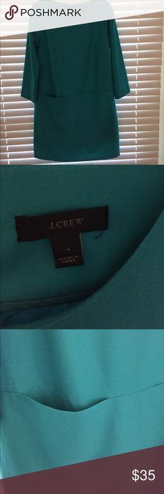 "J Crew dress Quality Wool and spandex dress with polyester lining; 2 front pockets; 17"" back plastic zipper; 34"" from shoulder to hem;   The color is greenish blue,; I would characterize as teal green J. Crew Dresses"
