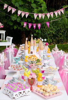 Princess theme: The dessert table with a magnificent birthday cake-shaped castle with ice cream cones in place of the towers.