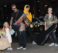 Headed home? Victoria and David were joined by their whole brood, Brooklyn, 17, Romeo, 13, Cruz, 11 and Harper, five for their flight
