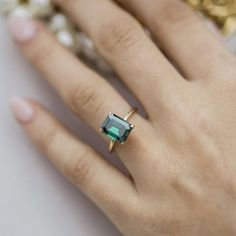 This carat elongated emerald cut solitaire, with a fancy dark green Moissanite stone, is a beautiful update to a timeless style. As with all of our engagement rings, this setting is designed so bands can sit flush. Solitaire Engagement, Vintage Engagement Rings, Wedding Engagement, Expensive Jewelry, Gold Diamond Rings, Emerald Rings, Gold Ring, Moissanite Rings, Morganite Ring
