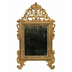 A stunning Italian late 17th century Louis XIV period triple framed giltwood mirror with the original mirror plates. The mirror is raised on two richly carved reeded scrolled supports with an acanthus leaf  pattern that continues up each side. The original mirror plates are framed within three carved giltwood frames accented with giltwood rosettes.  At the top is the outstanding pierced top crown with a large scrolls, flowers and acanthus leaves.  All original gilt.