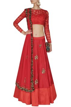 This set features a red lehenga in silk base with pearl and sequins flower motifs scattered all over and a lighter red silk broad border. It has a can-can under #redcolorsilklehengacholi