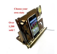 Dock station from dark wood, Florida dock station, cool mens gift, Personalised dock station, tablet holder, ipad stand, Girlfriend gift. Personalised dock station is a perfect gift for yourself or someone you love! This wooden dock station feature a convenient place to store your smartphone, notebook, pens and pencils, keys, sunglasses, watches and wallets. This Phone dock was designed to accept smartphone and other things of any size. The dock station is travel friendly. Disassembled…