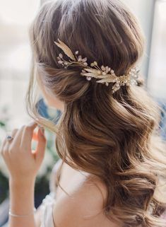 We're loving this romantic bridal hairstyle (especially the gorgeous gold hair accessory). #BridalHairstyle
