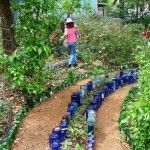 Collect and Up-cycle Glass Bottles Into Creative Colorful Garden Edging DIY Garden Bed Edging Ideas Ready to Emphasize Your Greenery Diy Garden Bed, Garden Edging, Garden Crafts, Garden Projects, Garden Art, Path Edging, Garden Types, Art Projects, Reuse Wine Bottles