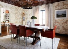 The wood-paneled ceiling and chandelier are original to the house. A Spanish trestle table is juxtaposed against Design Within Reach chairs. - Photo: John Merkl / Design: Kari McIntosh Dawdy