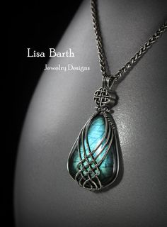This pendant has a gorgeous blue flash to the Labradorite. When the light hits it just right the stone lights up a beautiful blue. The wire work