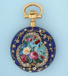 Fine, rare and beautiful Patek Philippe 18K gold, diamond and enamel repousse pair case ladies antique pendant watch circa 1895. This watch is in the style of watches made 100 - 200 years earlier. The outer case repousse with a classical scene. White enamel dial with blue and red numbers and fancy gold hands. The inner case covered with cobalt blue enamel and 47 diamonds, the back with a cartouche of painted enamel flowers. The movement in a third inner case with crystal over the nickel 18…