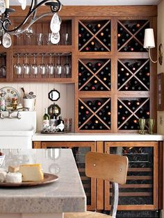 Add Unique Touches - Use Special Cabinet Features - Modular cabinets designed to hold bottles and stemware create a custom look. Take Care of Your Wine - Undercounter wine refrigerators keep bottles properly chilled in a small amount of space. Doors fitted with wooden frames integrate the appliances into the cabinets.