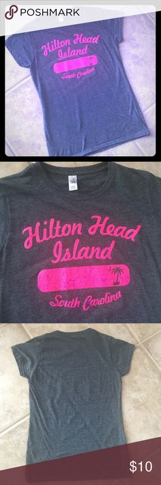 ✨HILTON HEAD ISLAND✨ t-shirt NWOT NWOT Hilton Head Island t-shirt.  Charcoal gray with bright pink lettering.  Ladies fit size medium - fits snug for a medium.  65% polyester, 35% preshrunk cotton.  Brand new without tags. Tops Tees - Short Sleeve