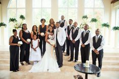 Bridesmaids in Jumpsuits, Groomsmen in Vest & Stripped Ties. Modern Chic Wedding Black & White with a touch of Gold Wedding