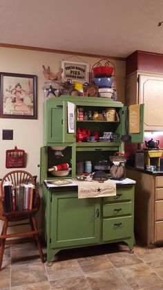 Hoosier Cabinet, old scales, rolling pins, Blue Willow dishes, crock bowls, vintage Red 404 Pyrex bowl.