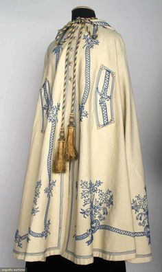 White Knee Length Cape With Dark Blue Soutache Embroidery In Fanciful Pattern, Peaked Hood With Tassels   c.1850-1890