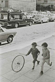 Henri Cartier Bresson has sucessfully implemented movement in this image. The two young boys playing with the wheel as they run through the streets. Bresson has created a mood of fun, carelessness and innocence through the two young boys.