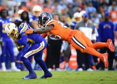 Broncos vs. Chargers:   October 13, 2016  -  21-13, Chargers   -     Dexter McCluster #33 of the San Diego Chargers runs for a first down as he is tackled by Darian Stewart #26 of the Denver Broncos during the second quarter at Qualcomm Stadium on Oct. 13, 2016 in San Diego.