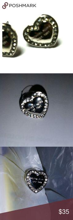 Michael Kors heart silver earrings Sliver w/Michaal kors est. 1981 on the heart, with lots of crystals surrounding heart, post earrings Michael Kors Jewelry Earrings