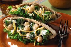 Vegetarian Pita Pockets recipe-Lettuce-lined pita pockets are filled with a tasty mix of chopped broccoli, reduced-fat cheddar, garbanzo beans and reduced-fat ranch dressing. #lunch