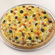 "Mexican Pizza - ""You can add shredded chicken and taco seasoning for meat lovers or leave the meat off for a quick vegetarian meal."