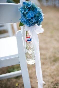 Vintage Pepsi bottles wedding aisle floral decor. Photography by seastudio.us