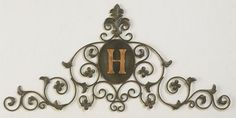 """Faux Green Brown Leaf  Fleur de Lis Monogrammed Wall Topper Free Shipping! Free Hanging Tapestry Rod! 30-Day Money-Back Guarantee! 1-Year Manufacturer Warranty!  Forged by master craftsmen of iron and tole, this stunning wall grille can be customized by specifying a 5"""" Gold iron letter (A-Z). Shown here with the letter """"H"""".    * Please make letter selection in """"Options"""" box. * Note: All letters are available in upper case print only. *PLEASE NOTE: This item is made to order.  Due to the ..."""