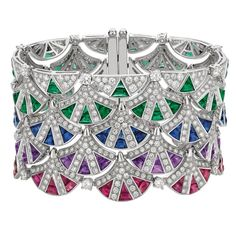 Bulgari's blue, pink and purple sapphire, emerald and diamond white gold cuff plays on the shapes of Diva's Dream