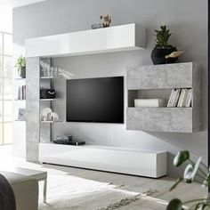 10 Ideas About Modern Tv Wall Unites To Impress You Home Designs Modern wall units have made decorating a home office that much easier. They come in a range of shapes, sizes and colors. By incorporating the use of t. Modern Tv Unit Designs, Modern Tv Wall Units, Living Room Tv Unit Designs, Modern Wall, Tv Wanddekor, Tv Storage Unit, Living Room Tv Cabinet, Modern Tv Cabinet, Tv Unit Furniture