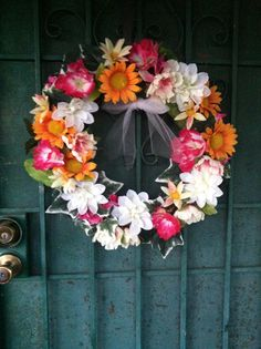 Spring/summer Wreath DIY! I bought the flowers at a dollar store and bought a trig wreath at Walmart for 7$ and with a hot glue gun did everything.