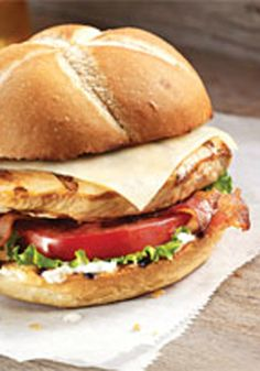 Grilled Chicken-Asiago Ranch Club -- In just 20 minutes, this delicious chicken sandwich recipe is ready for the dinner table--prepared with bacon and cheese and served on a kaiser roll.
