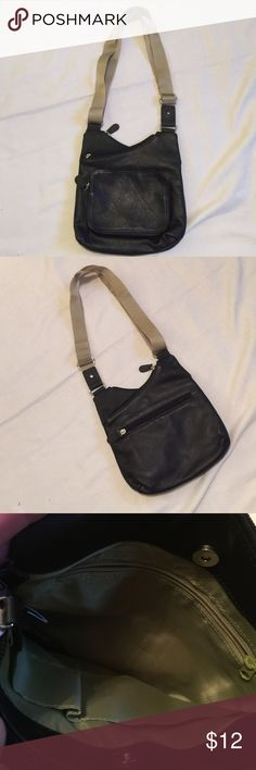 Mundi Crossbody Leather and nylon bag with a lot of pockets. Perfect for traveling or if you don't carry much.  Like new  Mundi Bags Crossbody Bags