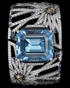 Cartier Oriental Influences – High Jewelry Bracelet White gold, one 67.93-carat emerald-cut aquamarine, rose-cut brown diamonds, aquamarines, obsidian, brilliants