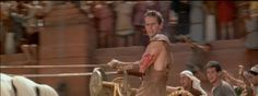 Judah Ben-Hur triumphant on his chariot looks back at the defeated Messala. Ben-Hur 1959