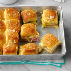 Cuban Sliders Recipe -Bake till these wonderful little rolls are lightly toasted and the cheese melts. The leftovers keep really well in the fridge, and they make a lovely cold snack. Followers of my blog, houseofyumm.com, go nuts for these! —Serene Herrera, Dallas, Texas