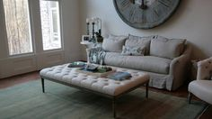 Rough linen sofa and tufted coffee table.