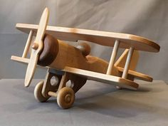 This robust small biplane is made to last and forced to give years of t . - Home Decor -DIY - IKEA- Before After Making Wooden Toys, Handmade Wooden Toys, Wooden Diy, Wooden Airplane, Wooden Toy Cars, Wood Toys Plans, Wooden Projects, Toy Trucks, Kids Furniture