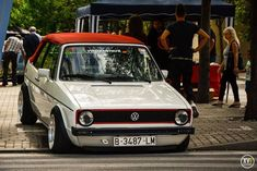 white VW Golf Cabriolet Mk1 with red top