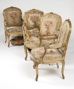 Four Carved Giltwood Fauteuils a La Reine. Early 20th century, each with a cartouche-shaped back joined to a serpentine seat by padded arms, upholstered in Aubusson style floral tapestry fabric.