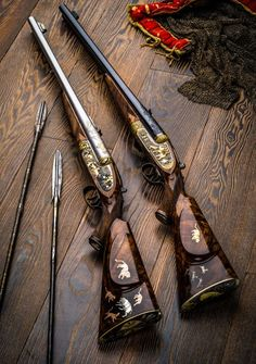 Elaborately decorated double rifles for show. Plain Jane's were the original working guns of Africa and the white hunters of early African fame.ur guns and I'm arrows ❤️💋❤️African rifles for big-game. These double-barreled Holland & Hollands Weapons Guns, Guns And Ammo, Gun Art, Custom Guns, Hunting Rifles, Bow Hunting, Cool Guns, Le Far West, Firearms