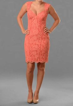 Rent this gorgeous coral lace sweetheart dress from Hera! Pair this Nicole Miller dress with our coral lace halter dress for a mix and match bridal party.