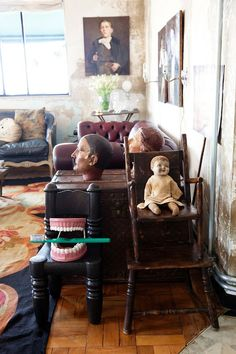 Art everywhere! Eclectic and full of oddities. Note set of giant false teeth with large toothbrush!