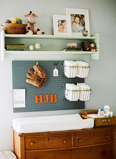 This is a really cute vintage inspired nursery.  I love the wooden crate as storage in this picture, and the idea of the peg board with the wire baskets for functional storage, but also some decorative touches on it.  Very cute for a boy's nursery!